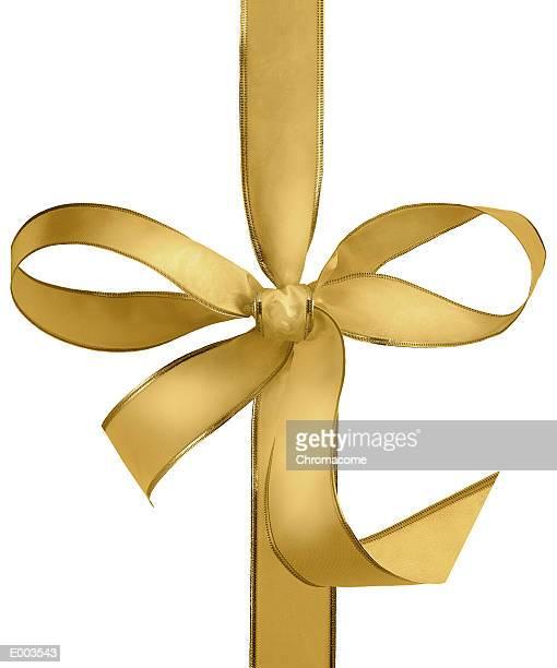 Gold bow of ribbon