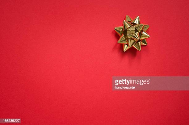 Gold bow on christmas red background