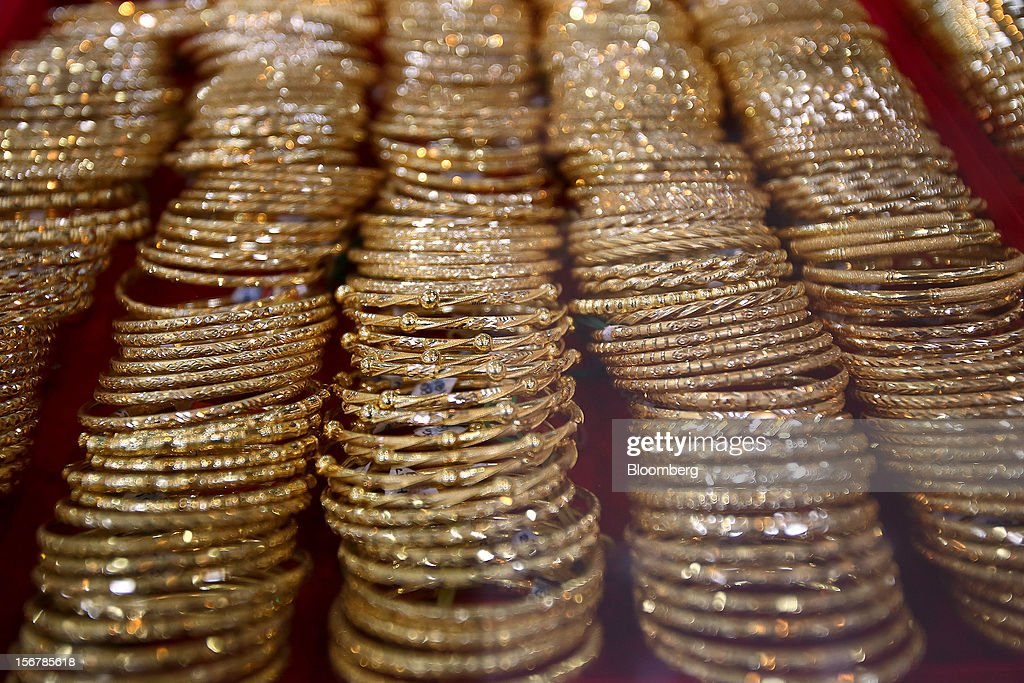 Gold bracelets are displayed for sale at a jewelry store in Yangon, Myanmar, on Tuesday, Nov. 20, 2012. Myanmar's growth outlook has improved 'substantially' amid political reforms, which are expected to lead to a large influx of foreign investment, the Organization for Economic Cooperation and Development (OECD) said on Nov. 18. Photographer: Dario Pignatelli/Bloomberg via Getty Images