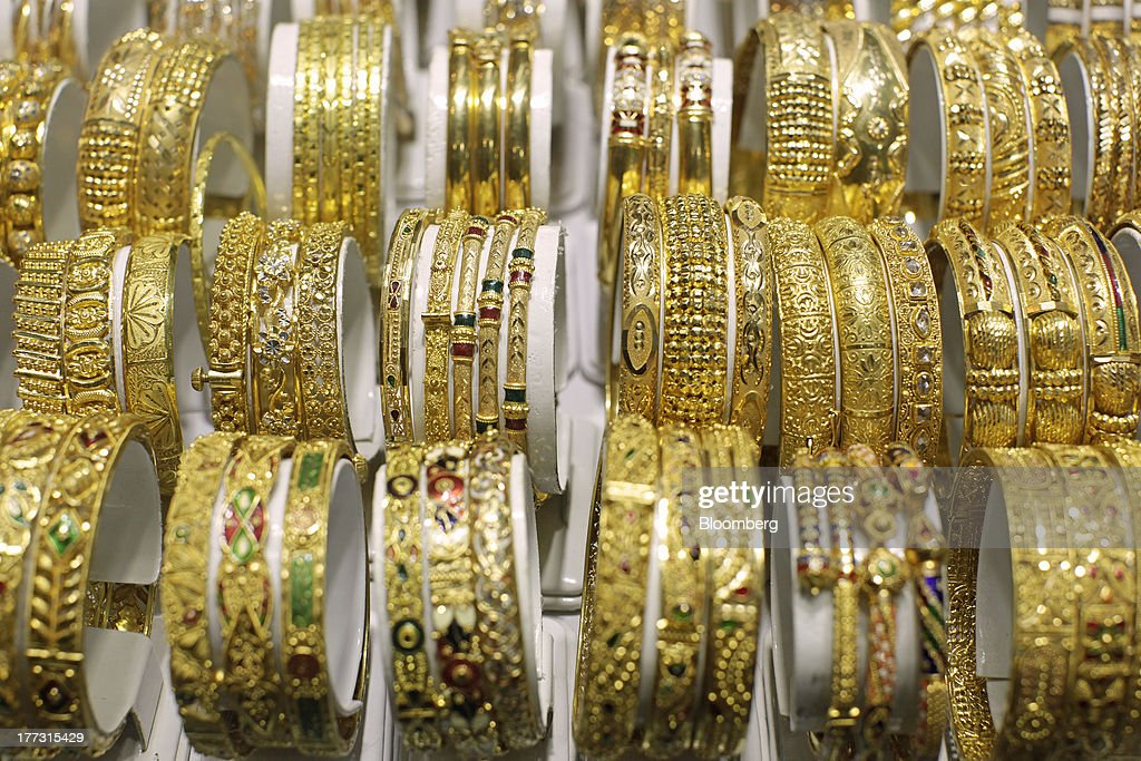 Gold bracelets sit in a display cabinet at a jewelry store in Jakarta, Indonesia, on Thursday, Aug. 22, 2013. Gold jewelry demand in Indonesia is set to expand to a four-year high as consumers in Southeast Asia's biggest buyer join India to China in increasing purchases as prices slump and the middle class expands. Photographer: Dimas Ardian/Bloomberg via Getty Images