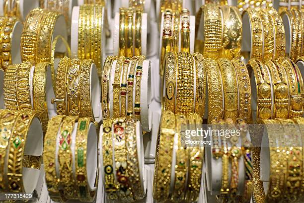Gold bracelets sit in a display cabinet at a jewelry store in Jakarta Indonesia on Thursday Aug 22 2013 Gold jewelry demand in Indonesia is set to...