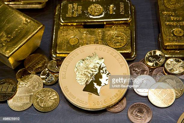 Gold bullion and gold coins in the strong room of pro aurum goldhouse in Munich In the foreground the Australian Nugget