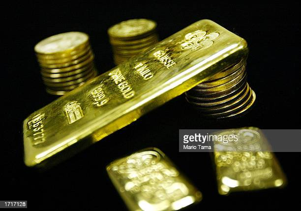 Gold bullion bars and coins are seen for sale at Manfra Tordella and Brookes Inc January 9 2003 in New York City The price of gold has risen by...