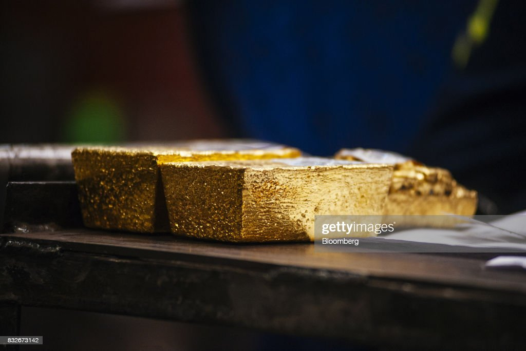 Gold bullion bars sit following casting at the Rand Refinery Ltd. plant in Germiston, South Africa, on Wednesday, Aug. 16. 2017. Established by the Chamber of Mines of South Africa in 1920, Rand Refinery is the largest integrated single-site precious metals refining and smelting complex in the world, according to their website. Photographer: Waldo Swiegers/Bloomberg via Getty Images