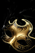ornate carnival mask over black background