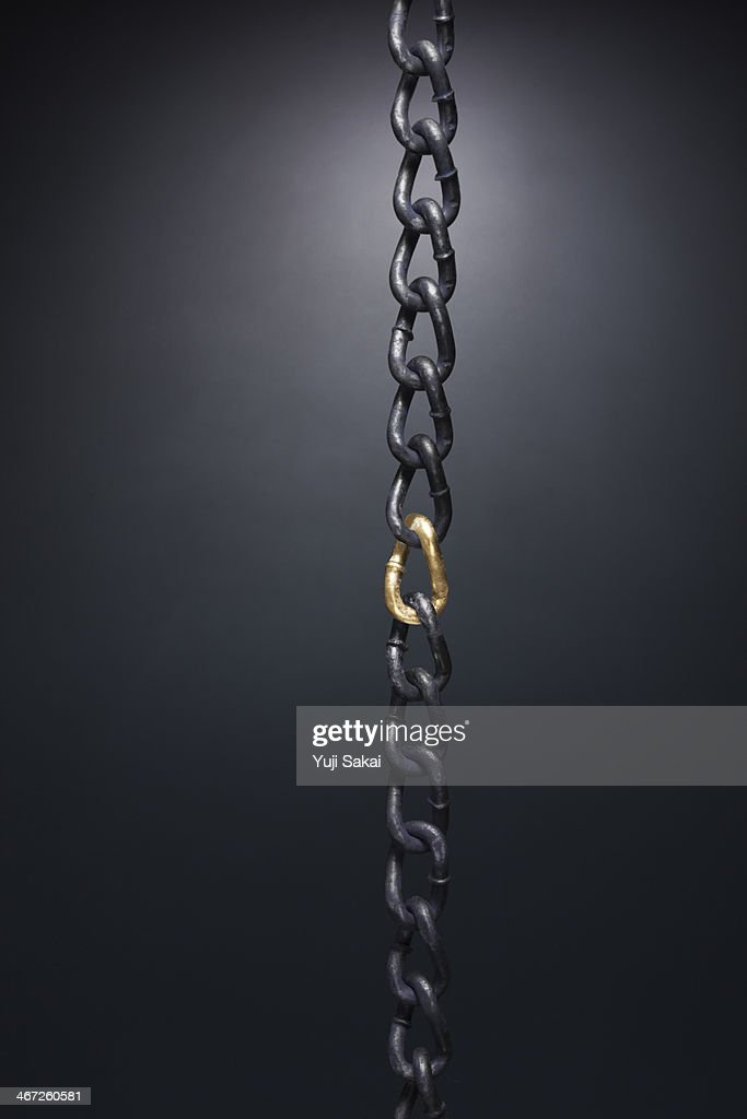 gold chain  between  the chain : Stock Photo