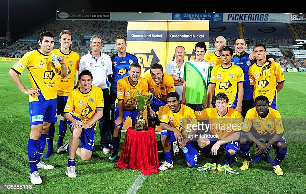 Gold Coast United pose with the Queensland Nickel Cup after winning the round 12 ALeague match between the North Queensland Fury and Gold Coast...