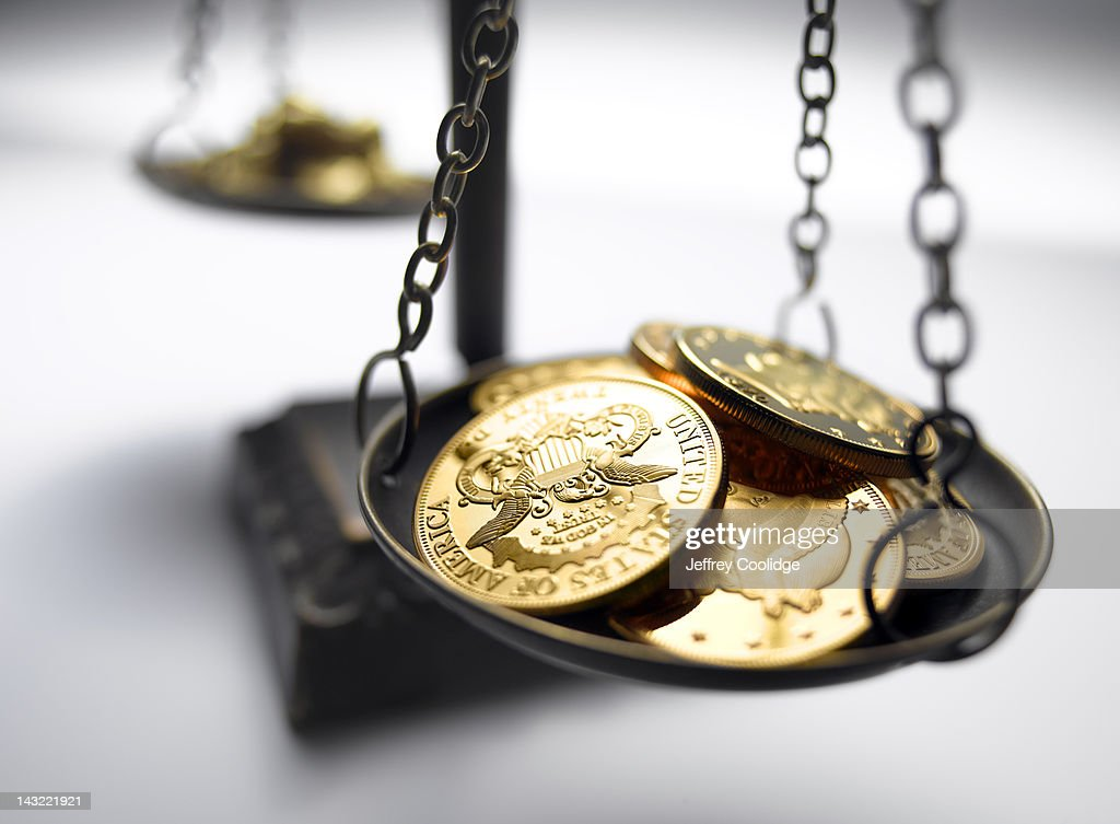 Gold Coins on Scale : Stock Photo