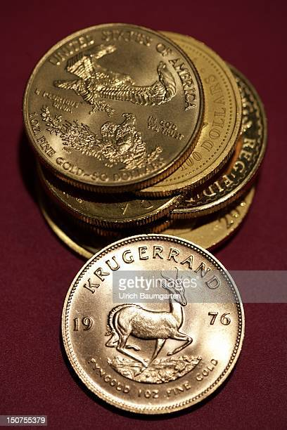 GERMANY MUNICH gold coins Oour picture shows the Kruegerrand 1 oz fine gold Suedafrika and fine gold coins of different states