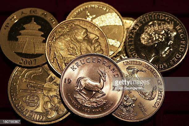 GERMANY MUNICH gold coins Oour picture shows the Kruegerrand 1 oz fine gold Suedafrika American Eagle American Buffalo Wiener Philharmoniker China...