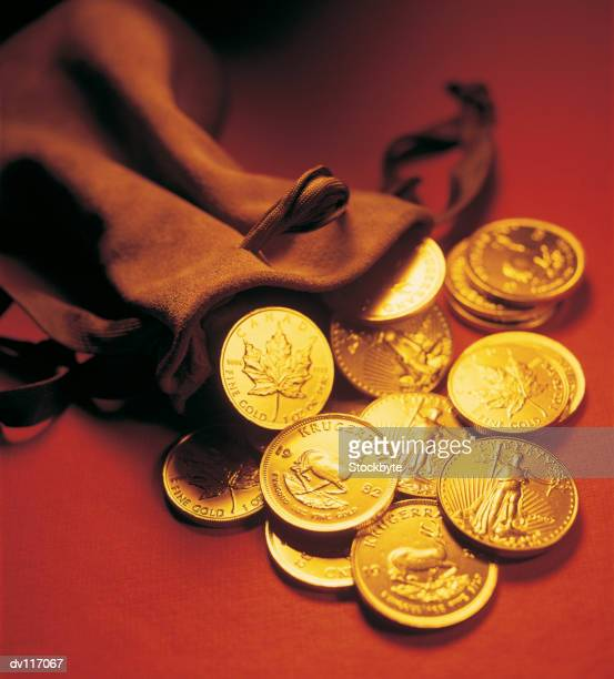 Gold coins spilling out of sack