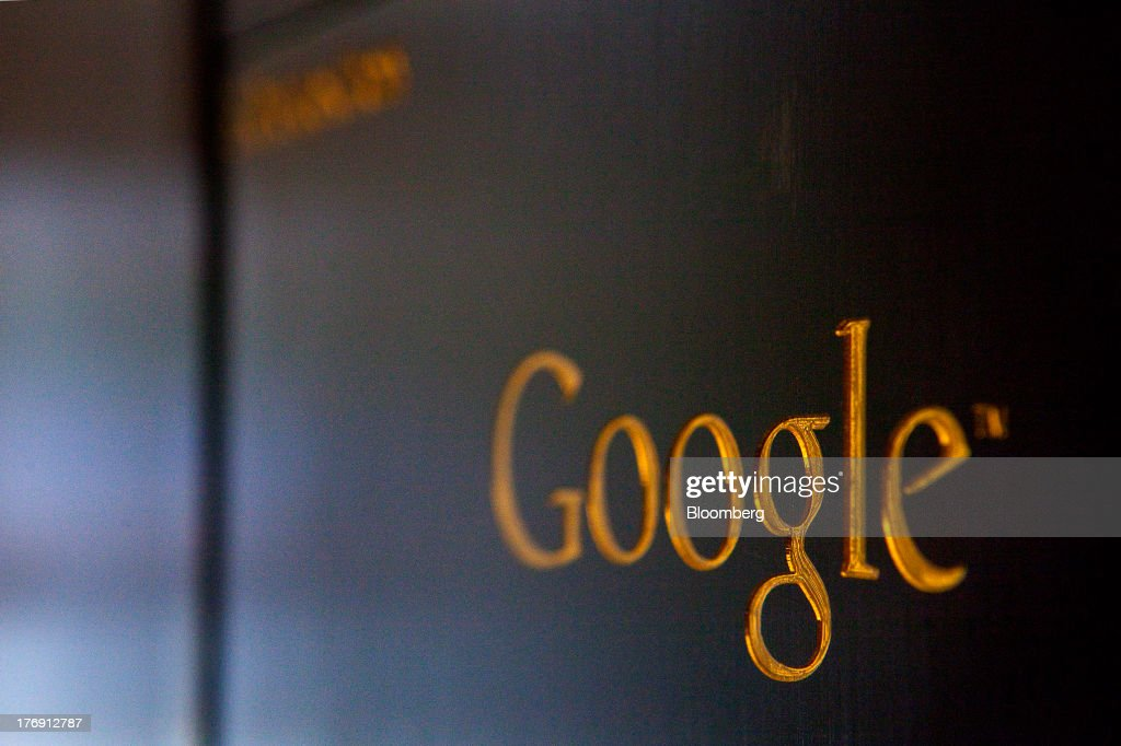 A gold colored Google Inc. logo sits on a sign outside the company's offices in Berlin, Germany, on Friday, Aug. 16, 2013. Google, based in Mountain View, California, is seeking to revive Motorola Mobility's smartphone business, recently announcing a new flagship Moto X smartphone with customizable colors that will be assembled in the U.S. Photographer: Krisztian Bocsi/Bloomberg via Getty Images
