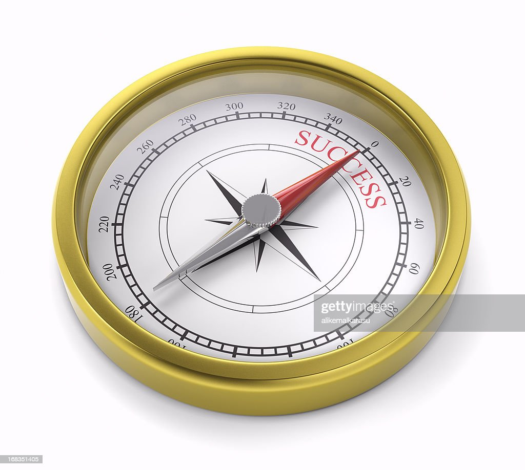 gold compass pointing to succes : Stock Photo