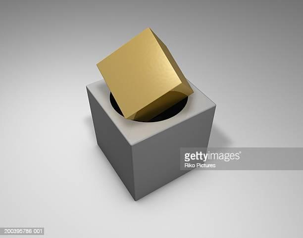 Gold cube on circular hole in  block (digital)