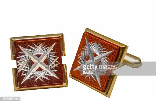 gold cufflinks on a white background : Stock Photo