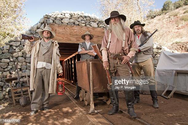 Gold diggers in front of a mine