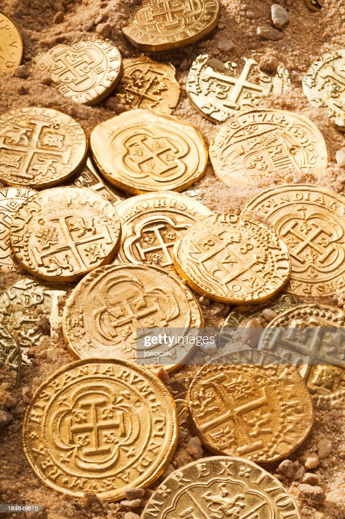 Gold Doubloons in Sand
