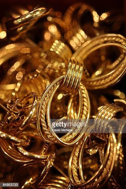 Gold earrings are displayed for sale February 20 2009 in Los Angeles California Gold futures finished the day above $1000 an ounce for the first time...