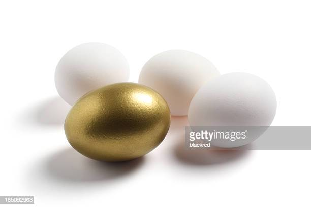 Gold Egg and Regular Eggs on White Background