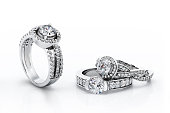 A beautiful diamond engagement rings in white gold  lay on a isolated white background.
