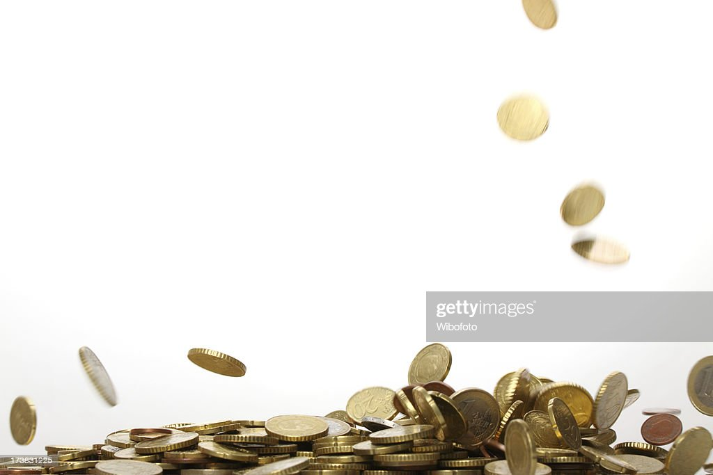 Gold euro coins falling and forming a pile