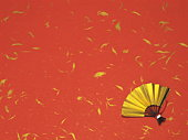 Gold fan on red and gold background