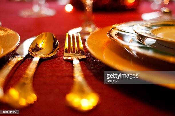 Gold Flatware Set on Red Tablecloth - Holiday Table Setting