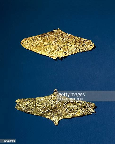 Gold foil diamondshaped lozenges decorated with rosette ornaments from Tomb 152 and 234 of the archaic Necropolis of Agia Paraskevi near Thessaloniki...