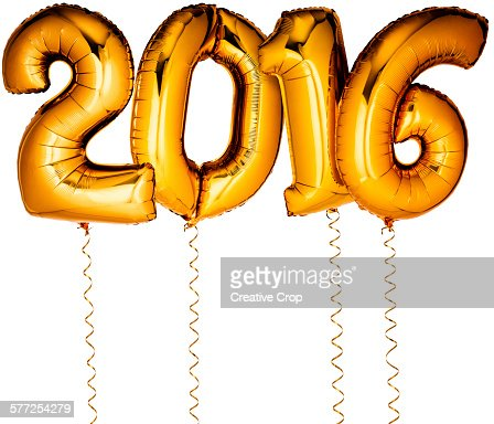 Gold foil party balloons in the shape of 2016