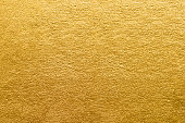 Gold foil texture. Golden abstract background close-up