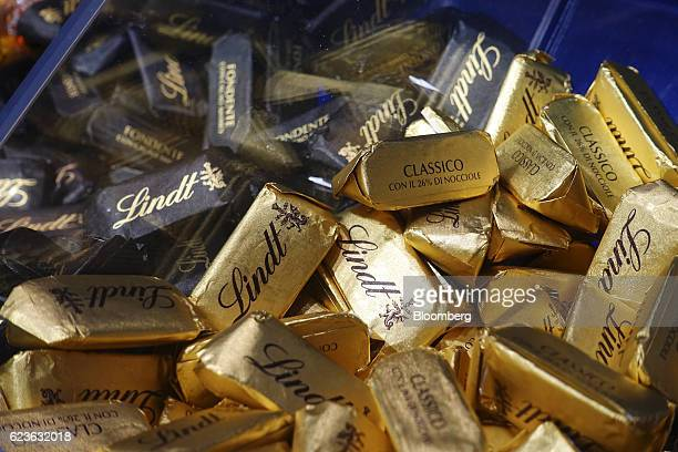 Gold foil wrapped chocolates produced by Lindt Spruengli AG sit on display in the window of a chocolatier in Lugano Switzerland on Tuesday Nov 15...