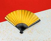 Gold folding fan on Japanese paper