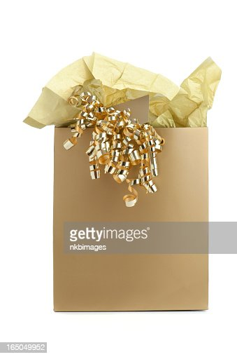 Gold gift bag with tissue paper and curly ribbon