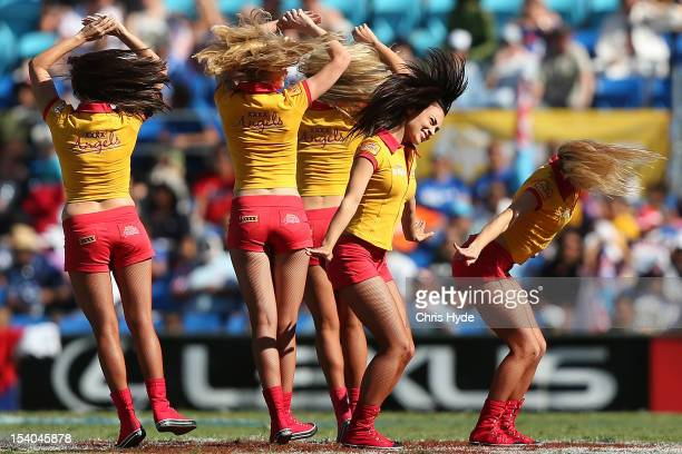 Gold girls dance during day one of the 2012 Gold Coast Sevens at Skilled Park on October 13 2012 in Gold Coast Australia