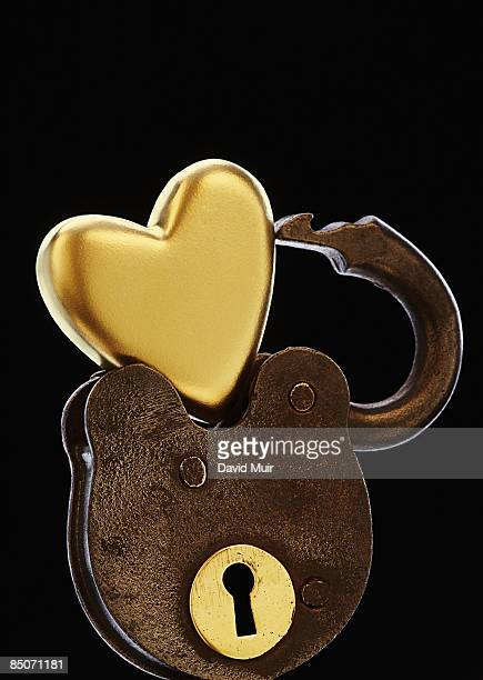 gold heart with an open lock
