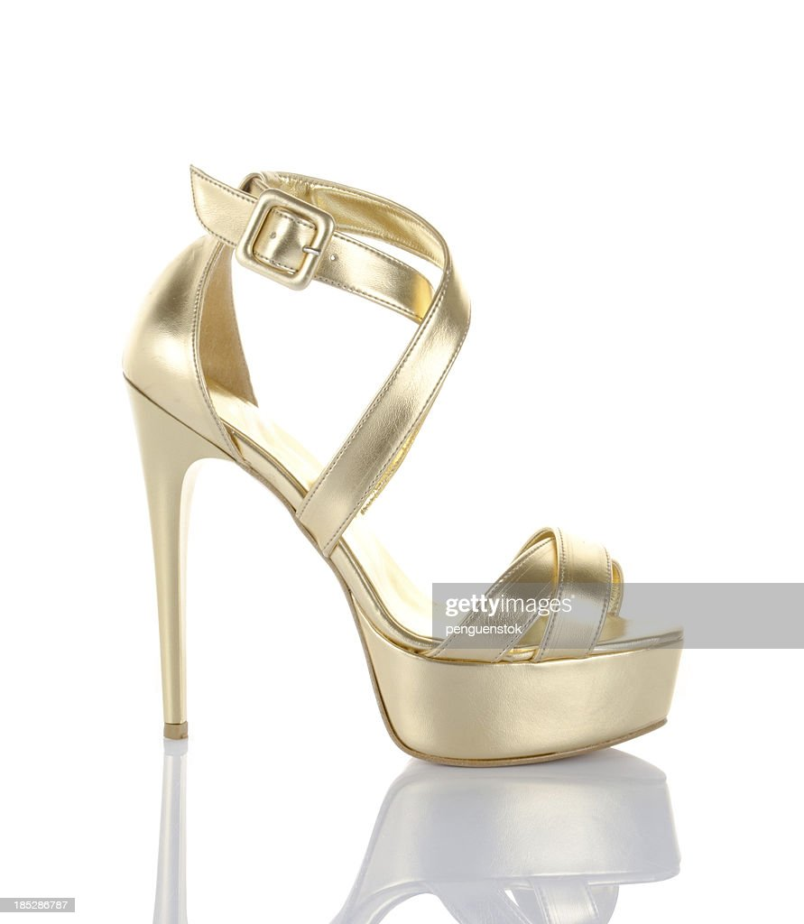 gold high heel shoe