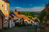 Famous view down Gold Hill, Shaftesbury in the early evening late summer sunshine