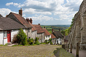 The famous Gold Hill, in Shaftesbury, North Dorset. Location for the making of the Hovis bread advert. Taken in the summer months with light cloud and good visibility.