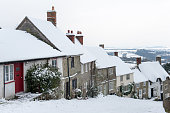 The famous Gold Hill, in Shaftesbury, North Dorset in winter. Location for the making of the Hovis bread advert. Taken in the winter months with covering of snow, cloud cover and good visibility into