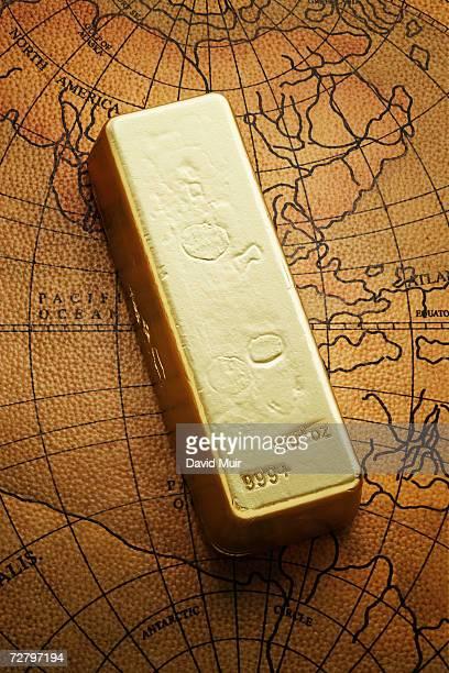 Gold ingot on world map