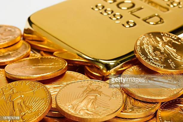 Gold ingot surrounded by golden coins