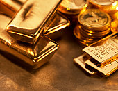 Gold ingots and coins close up