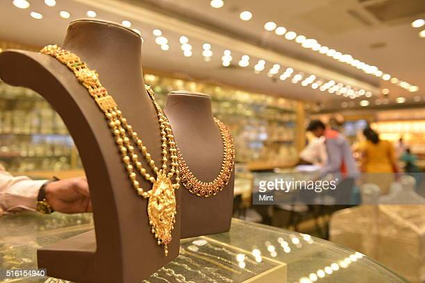 Gold Jewelry on display at Jewelers shop on May 28 2015 in Bangalore India