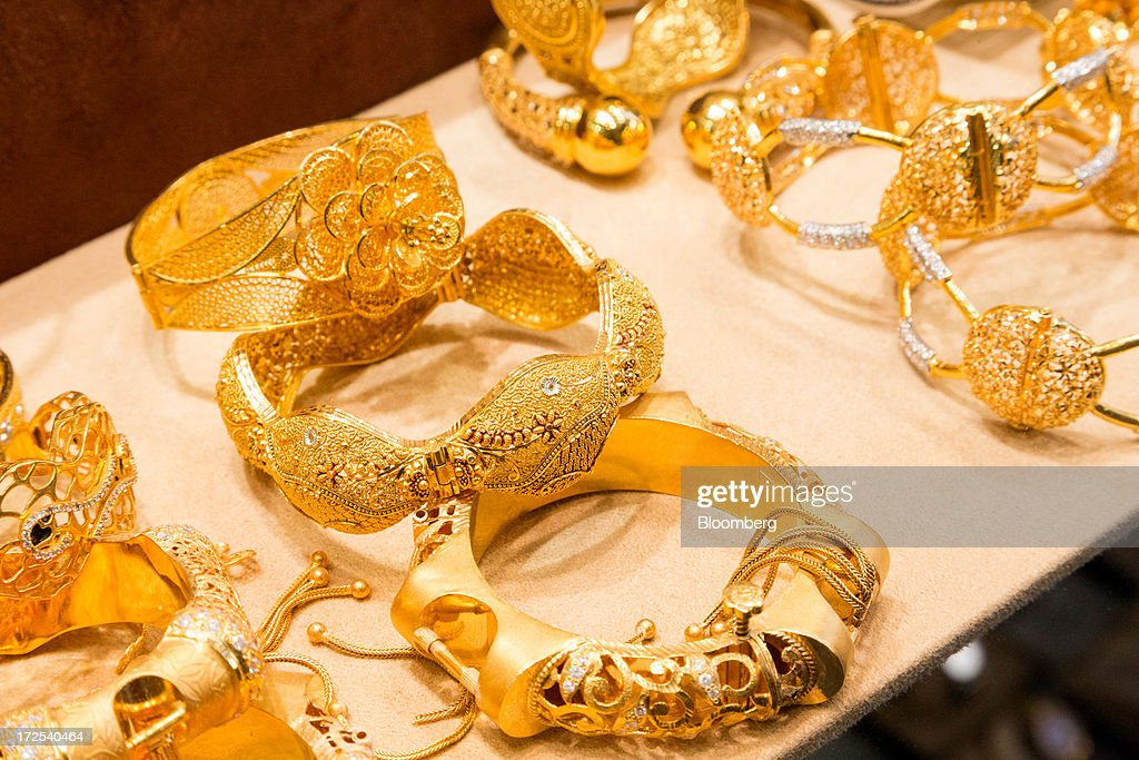 Gold jewelry sits on display in a gold store in the Dubai Gold Souk in the Deira district of Dubai, United Arab Emirates, on Tuesday, July 2, 2013. Gold swung between gains and losses in London as investors weighed prospects for increased physical demand against a slowing stimulus in the U.S. Photographer: Duncan Chard/Bloomberg via Getty Images