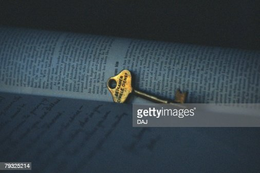 Gold Key on Book, Close Up, Differential Focus : Stock Photo