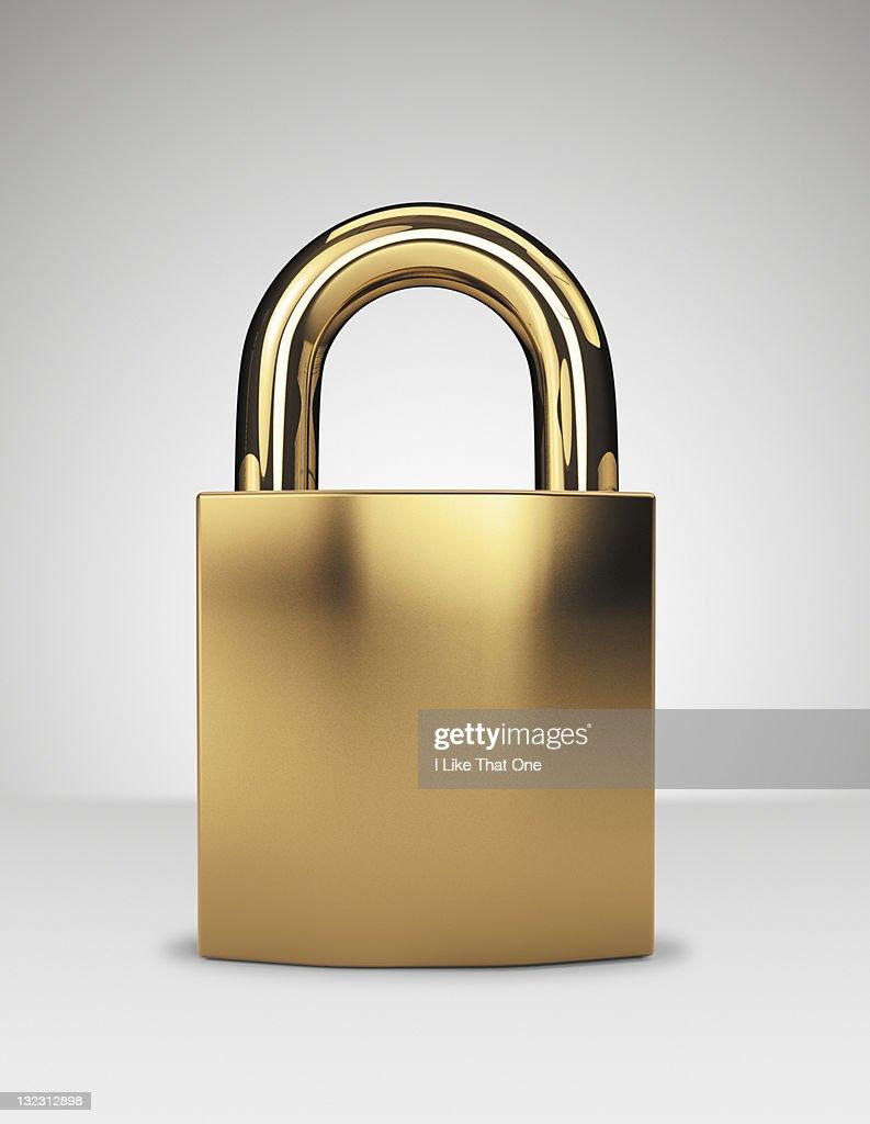 Gold locked padlock : Stock Photo