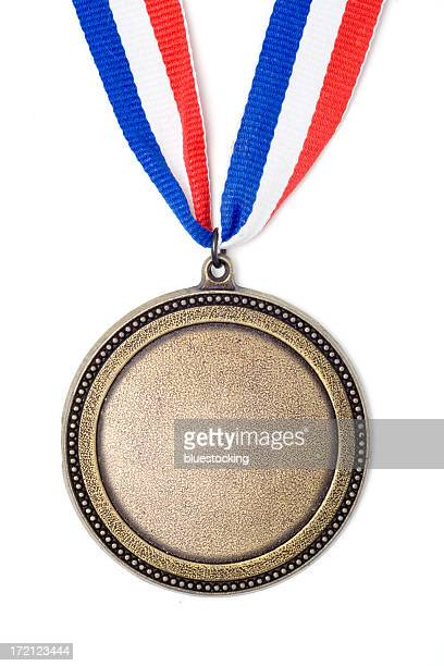 Gold medal award on red, white and blue ribbon
