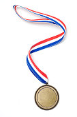 Gold medal award with red, white and blue ribbon