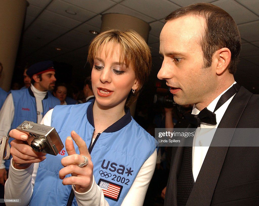 Gold medal figure skater Sarah Hughes and former Olympic figure skater Brian Boitano check out their photo taken by Hughes's mother Monday April 22...