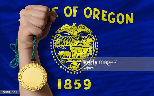 Gold medal for sport and  flag of oregon : Stock Photo